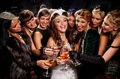 Beautiful women in evening dresses with champagne glasses