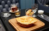 Meat pie on table in classic British pub
