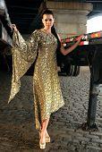 Fashion model posing in long designer evening dress at historical area