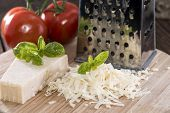stock photo of grating  - Heap of fresh grated Parmesan Cheese  - JPG