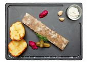 Meat aspic with baked potatoes and horseradish isolated on white, clipping path