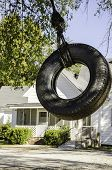 foto of tire swing  - Tire Swing in the Back Yard Moving Towards Me - JPG