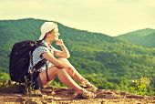 Woman Tourist With Backpack Sitting On Mountain Top