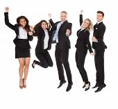 Постер, плакат: Successful Welldressed Businesspeople With Arms Raised