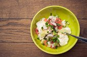 Fresh salad with tomatoes, cucumbers, radish, curd, green onions