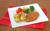 meat escalopes on white plate