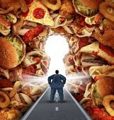 stock photo of obesity  - Dieting solutions and overweight diet advice concept as an obese man walking on a road to a heap of greasy junk food shaped as a key hole as a metaphor for answers to unhealthy food risk and the challenges of eating disorders resulting in obesity - JPG
