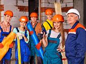stock photo of millwright  - Happy group people in builder uniform - JPG