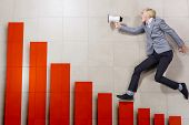 Businessman running on increasing graph. Growth concept