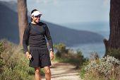 trail running man having fun exercising outdoors