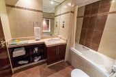 ABU DHABI, UAE - MARCH 30: Luxury bathroom of The Grand Midwest Tower Hotel in Dubai on 30 March 201