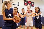 foto of 13 year old  - Female High School Basketball Team Playing Game - JPG