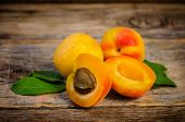picture of apricot  - apricots on a dark wood background - JPG