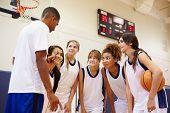 stock photo of 16 year old  - High School Basketball Team Having Team Talk With Coach - JPG