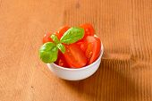 tomato salad with basil on wooden table