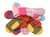 Heap Of Multicoloured Wool Mittens