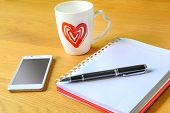 Open A Blank White Notebook And Cup Of Coffee