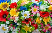 Background Of Artificial Flowers.