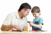 Man and kid child boy tinkering nesting box