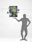 Funny man in full body suit holdig tablet pc, new technology concept