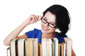 Happy woman searching for an interesting book.