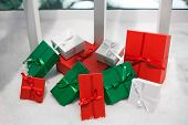 Coloured Gift Boxes On Snowy Background