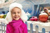 Small girl in winter interior