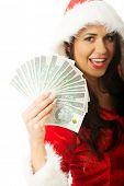 Portrait of beautiful santa woman holding a clip of polish money.