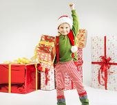 Smiling funny child with big gifts