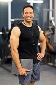 muscular male gym trainer portrait