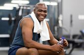 healthy african american man resting after workout