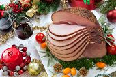 image of kumquat  - Christmas dinning table with glazed roasted ham with tomatoes herbs and kumquats - JPG