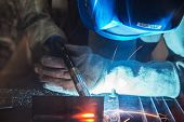 Close Up Of Worker With Protective Mask Welding Metal.selective Focus