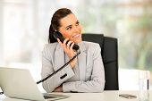 gorgeous office worker talking on telephone