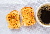 Coffee With Garlic Bread On Cloth Background