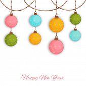 Happy New Year celebration background with colorful hanging Xmas balls on white background.