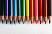 Colorful pencils arranged as a color pallete and isolated on white. Concepts of creativity, art, school etc.