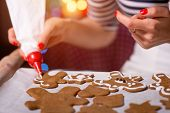 Woman making ginger cookies on Christmas