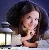 beautiful girl on winter snow