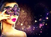 stock photo of mask  - Beauty model woman wearing venetian masquerade carnival mask at party over holiday dark background with magic stars - JPG