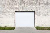foto of roller shutter door  - Building made of brick with roller shutter door - JPG