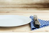 image of gizmo  - Dishes with fork blue knife and napkin - JPG