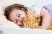 Pretty kid girl sleeping in bed