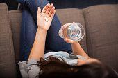 Taking Aspirins For A Headache