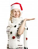 Woman with Santas hat waiting for Christmas, with open hand