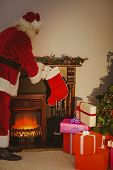 Father christmas stocking gifts at christmas eve at home in the living room