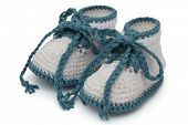 stock photo of booty  - Turquoise and White crochet baby booties isolated on white Hand - JPG