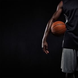 pic of sportswear  - Cropped image of black basketball player standing with a basket ball - JPG