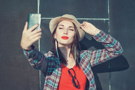 pic of birthmark  - Beautiful young girl in the hat taking picture of herself selfie - JPG