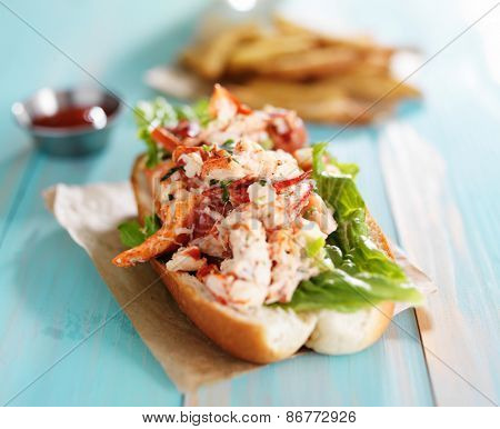 lobster roll on colorful retro painted wooden planks